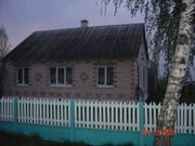 Дом кирпичный,  четыре комнаты,  гараж,  хозпостройки,  ванная,  туалет,  ле