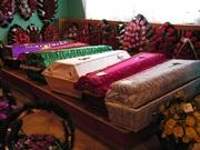 Погребальные гробы